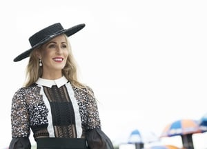 Mary Lee Gort chose a flat black hat to go with her sheer dress.