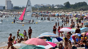 People enjoy the hot weather beach in La Grande-Motte, France