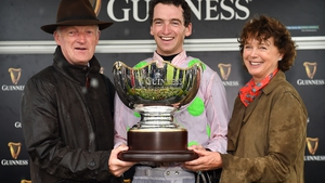 Jockey Patrick Mullins celebrates with father and trainer Willie and mother Jackie after winning the Guinness Galway Hurdle Handicap