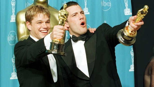 Damon and Affleck with their Best Original Screenplay Oscar for Good Will Hunting