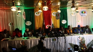 Zimbabwe Electoral Commission officials announce the results of the election during a press conference in Harare
