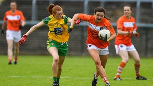 Tiarna Grimes of Armagh is tackled by Deirdre Foley in the Ulster final