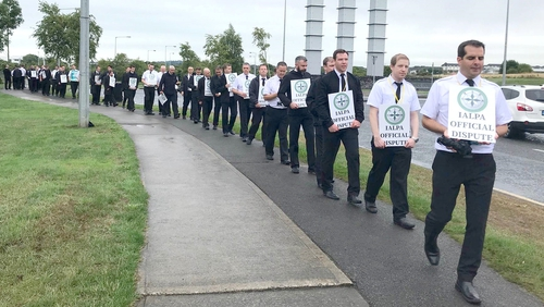 Ryanair pilots outside the company headquarters at Swords in Dublin today