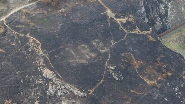 Irish grassfires reveal massive stone sign etched into coastland