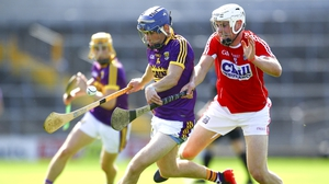 Wexford's Rory Higgins with Cork's Eoghan Murphy