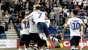 Alan Browne is mobbed by his teammates after giving his side the lead