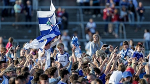 Monaghan supporters celebrate on the Salthill pitch after beating Galway