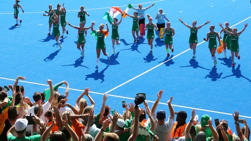 Victorious Irish players celebrate the win over Spain with supporters.