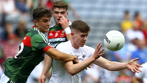 Kildare's David Marnell in action against Mayo's Tommy Conroy