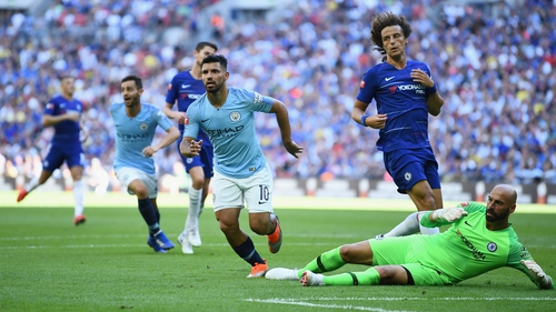 Sergio Aguero scores one of his two goals against Chelsea at Wembley