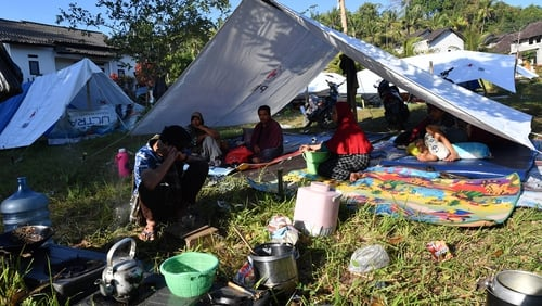 Villagers shelter in tents in west Lombok after the deadly quake