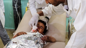 A child is treated by medics following the air strikes in Saada