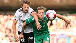 Karl Sheppard of Cork City holds off Vegar Hedenstad