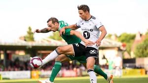 Karl Sheppard of Cork City in action against Vegar Hedenstad of Rosenborg