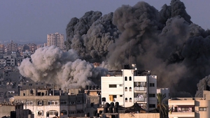 Smoke rising from a Gaza building hit during an Israeli airstrike