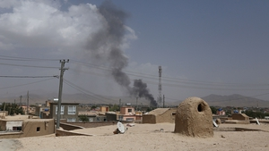 Smoke rising into the air after Taliban militants launch an attack on Ghazni