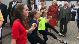 President Michael D Higgins and his wife Sabina watch some Irish dancing at the Fleadh