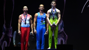 Rhys McClenaghan on the podium receiving his gold medal in Glasgow