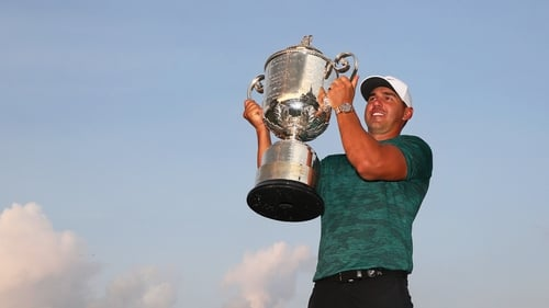 Brooks Koepka lifts the trophy