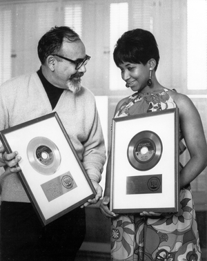 Singer Aretha Franklin and producer Jerry Wexler receive their gold records for their hit single 'I Never Loved A Man (The Way I Love You) in 1967 in New York city, New York. (Photo by Michael Ochs Archives/Getty Images)