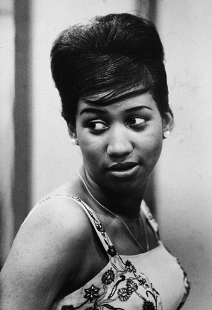 Aretha Franklin looks over her shoulder, her hair pulled up into a beehive style, 1961. Photo by Metronome/Getty Images)