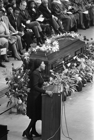 Aretha Franklin sings during the memorial service for gospel singer Mahalia Jackson at McCormick Place. As she sang 'Precious Lord,' mourners broke into tears and some fainted. About 5,000 persons attended the service.