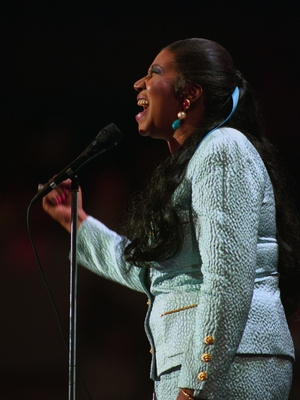 Aretha Franklin belts out the National Anthem at the Democratic National Convention on July 14, 1992