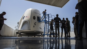 A mock up of the Crew Dragon spacecraft during a media tour of SpaceX headquarters and rocket factory