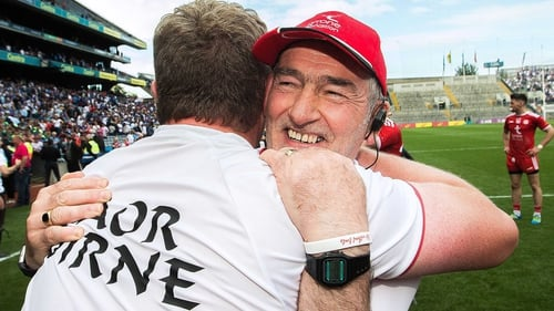 Mickey Harte embraces Tyrone assistant manager Greg Devlin after their defeat of Monaghan