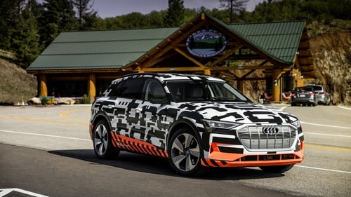 A disguised test version of Audi's first all-electric SUV.