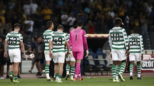 Celtic players trudge off after the defeat