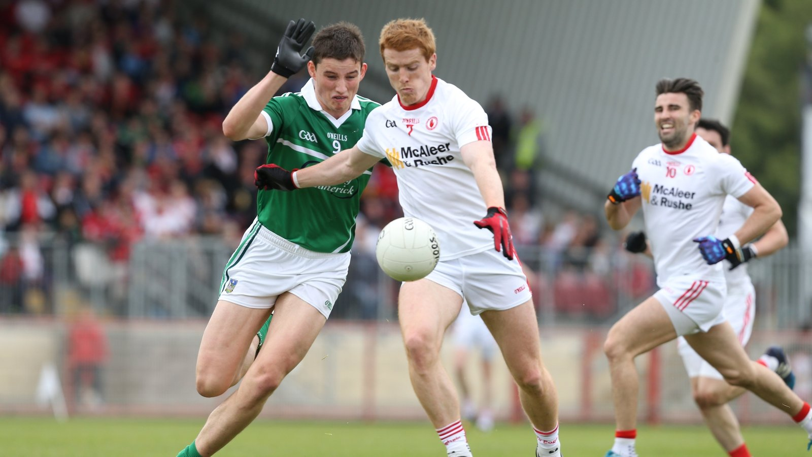 Image - Gearoid Hegarty attempts to tackle Tyrone's Peter Harte in the 2015 All-Ireland football qualifier