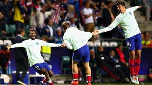 Antoine Griezmann(centre) and Atletico teammates Thomas Lemar (L) and Rodri celebrate their side's fourth goal