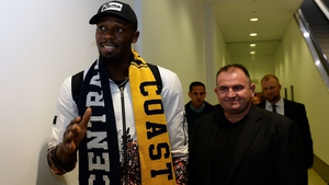 Usain Bolt makes his way through security as he arrives at Sydney international airport