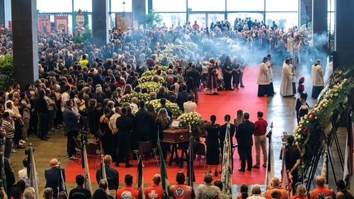 The mass for 19 of the victims was held at the Exhibition and Trade Centre of the northern port city and led by the city's archbishop, Cardinal Angelo Bagnasco