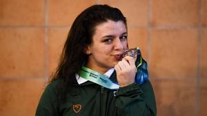 Turner celebrates after the medal ceremony