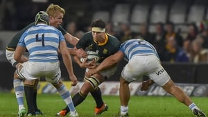 South Africa's flanker Francois Louw is tackled by Argentina's hooker and captain Agustin Creevy