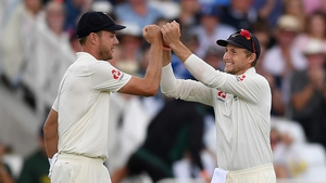Stuart Broad celebrates with Joe Root after taking another Indian wicket