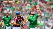 Darragh O'Donovan of Limerick in action against Johnny Coen of Galway