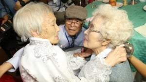 Cho Sun-do (L), 89, meets her  younger sister Cho Hye-do (R), 86, and younger brother Cho Do-jae (C), 75, during the inter-Korean family reunions