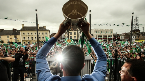 Limerick captain Declan Hannon lifts the Liam MacCarthy Cup outside Colbert  station