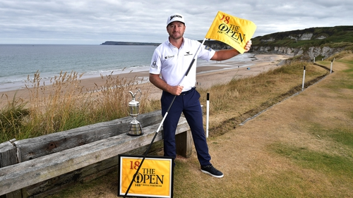 Graeme McDowell poses with the Claret Jug at the Antrim course