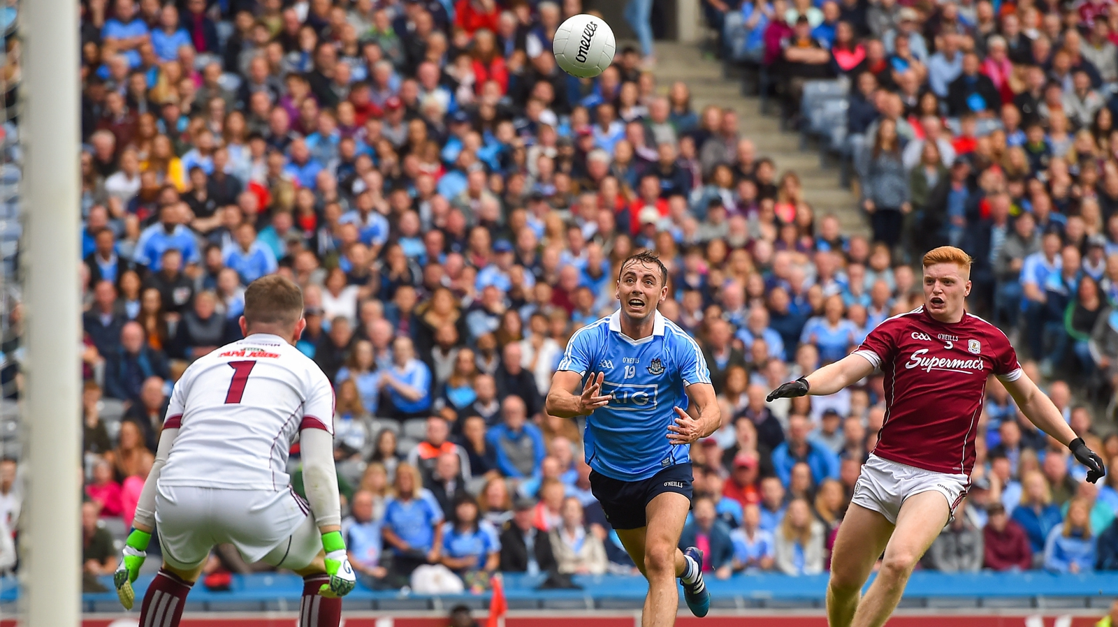 Image - Cormac Costello fists a point from close range in Dublin's semi-final win over Galway