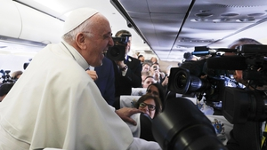 The Pope laughs while speaking to journalists on the flight to Dublin