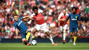 Jack Wilshere of West Ham United battles for posession with Alex Iwobi of Arsenal
