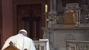 The Pope prays in silence at the Candle of Innocence for survivors of abuse