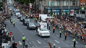Thousands line the streets as the Popemobile makes its way through the city centre