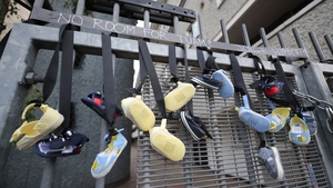 Pairs of baby shoes hang from the railings on Sean McDermott Street in Dublin in memory of the children who died at the Bon Secours Mother and Baby Home in Tuam, Co Galway