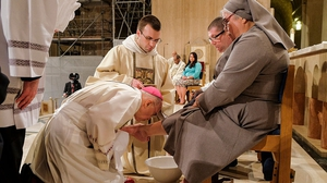 Archbishop Carlo Maria Vigano pictured in 2016 washing the foot of Sister Antonia Sanchez in Washington DC