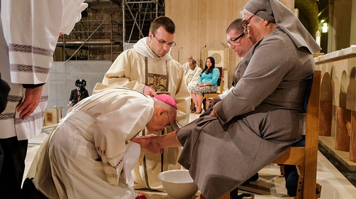 Archbishop Carlo Maria Vigano pictured in 2016 washing the foot of Sister Antonia Sanchez in Washington DC
